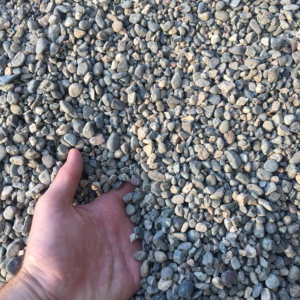 Pea gravel is very versatile often used to cover driveways and fill spaces between stone pavers it also serves as a good weed barrier and wont decompose